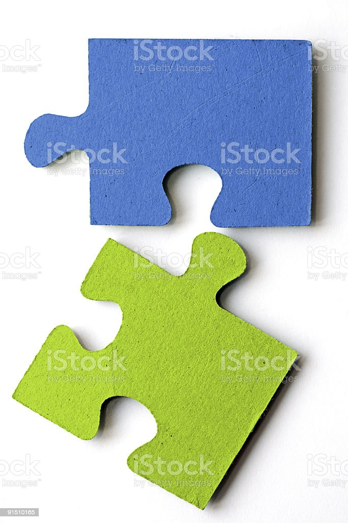 Blue and green jigsaw puzzle pieces on a white background royalty-free stock photo