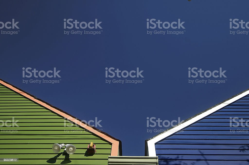 Blue and green roof peaks against deep blue sky royalty-free stock photo