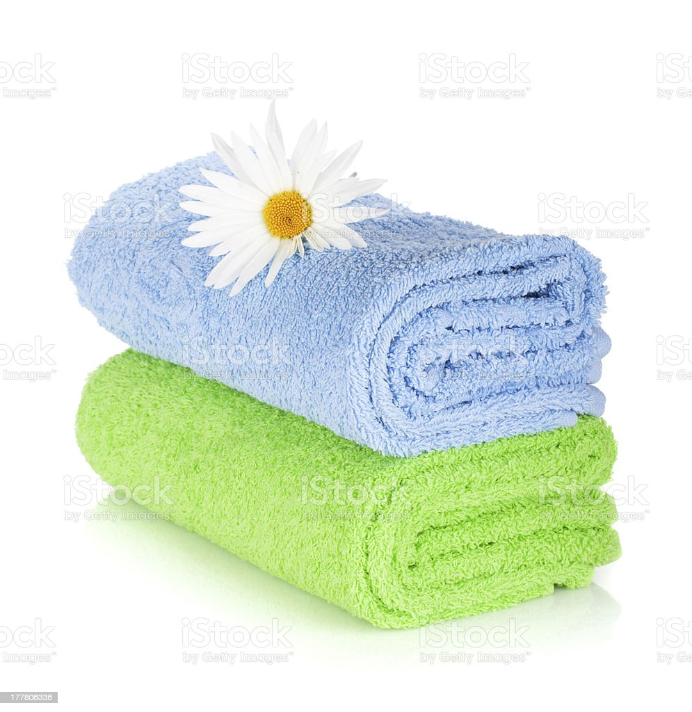 Blue and green towels with camomile flower royalty-free stock photo