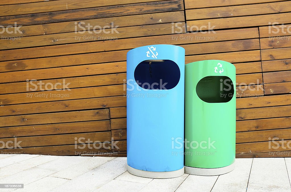 Blue and green Trashcan royalty-free stock photo