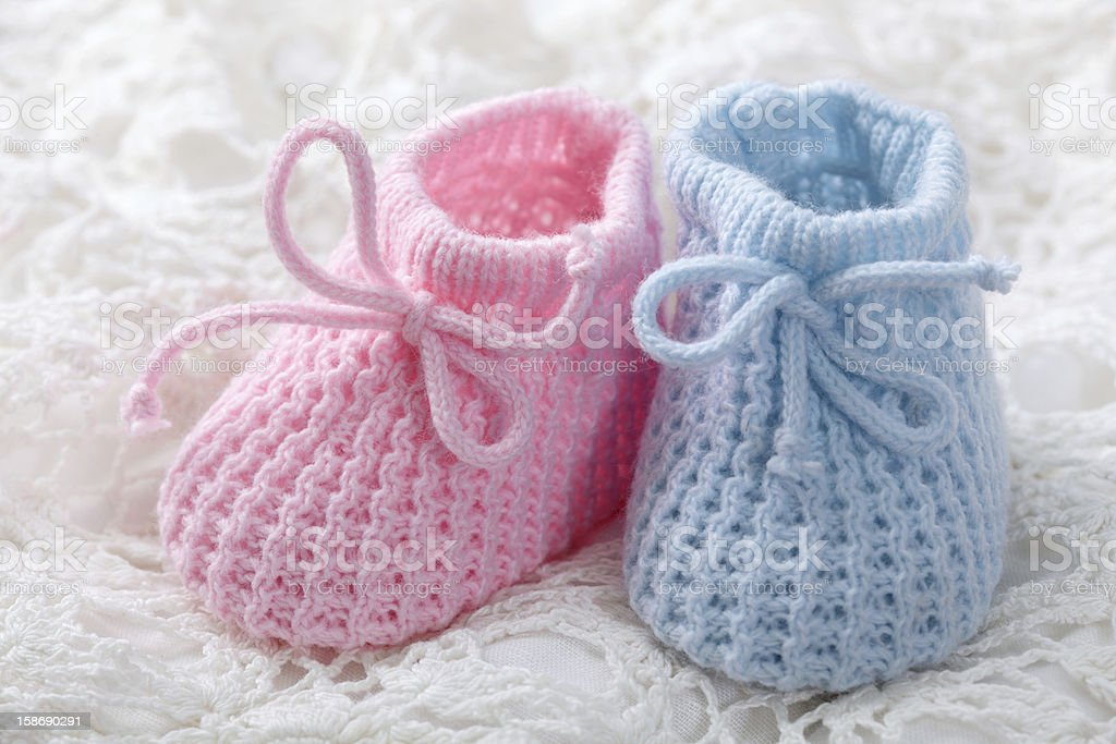 Blue and pink baby booties stock photo
