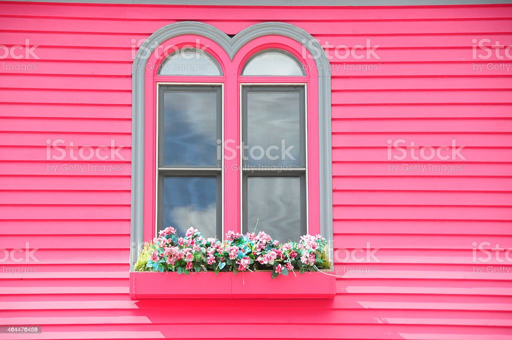 blue and pink building exterior stock photo