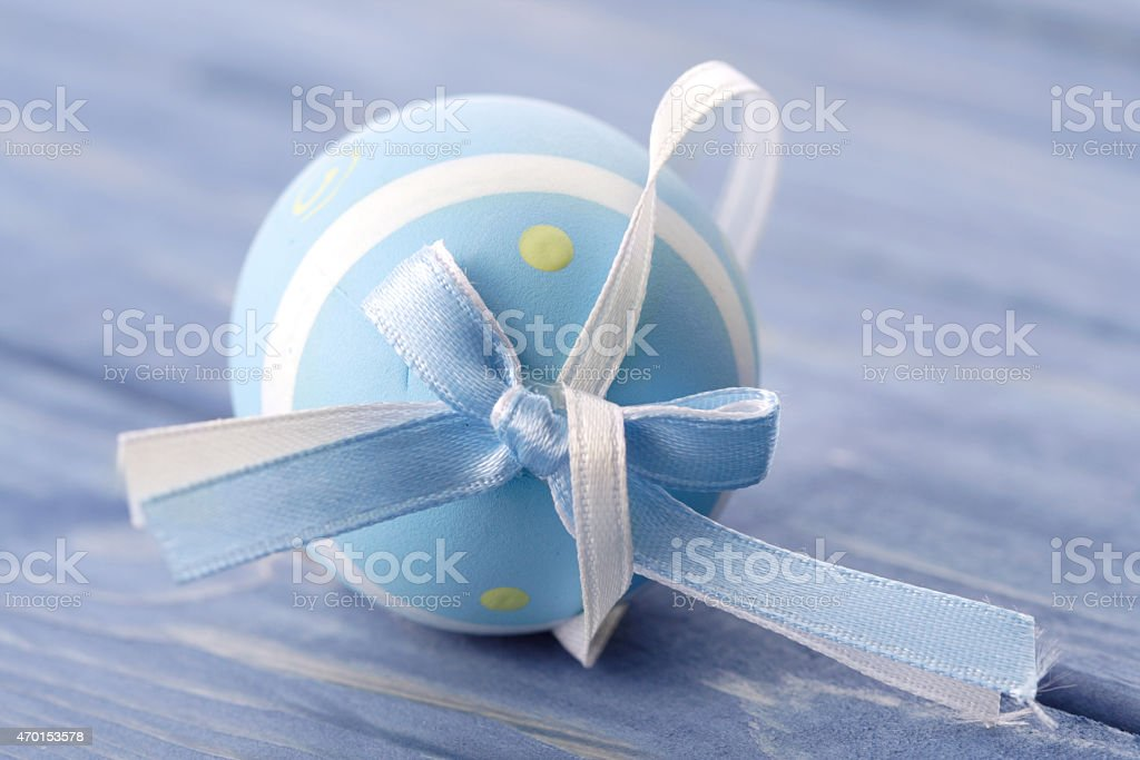 Blue and pink easter egg on blue background stock photo