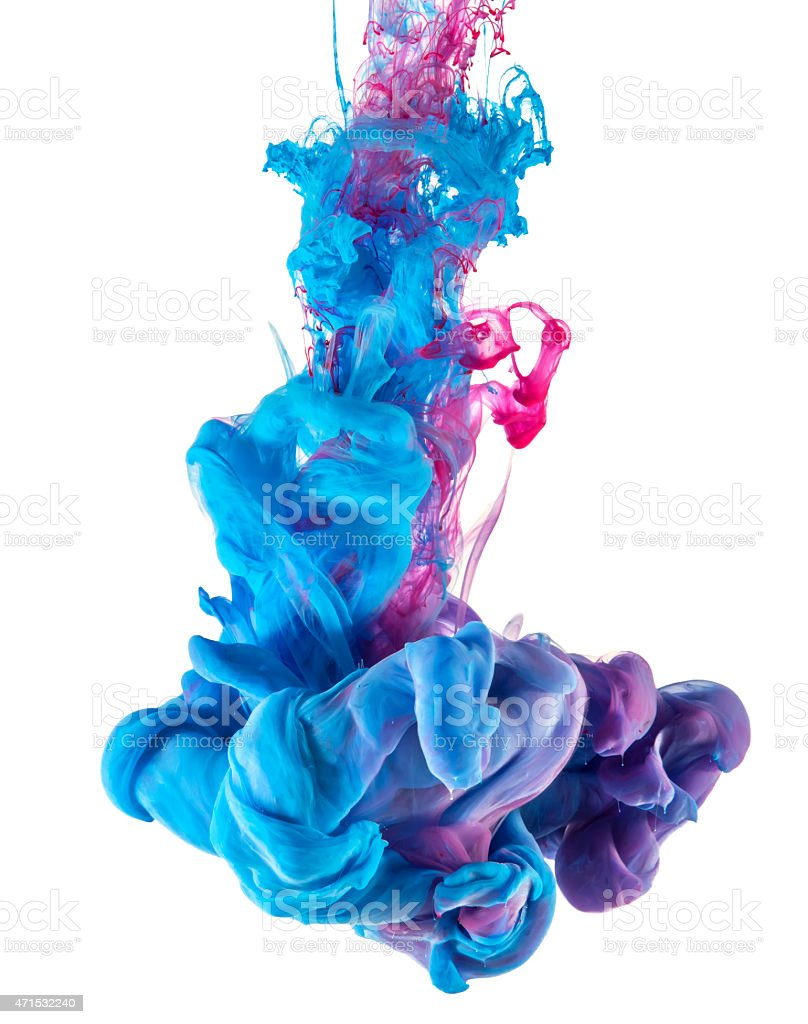 blue and pink ink color drop underwater stock photo