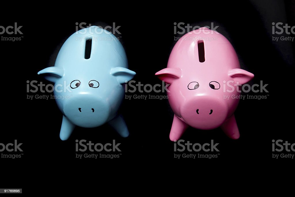 Blue and pink piggy bank style money boxes royalty-free stock photo