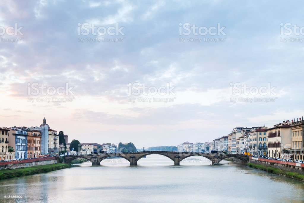 blue and pink sunset clouds over Arno River stock photo