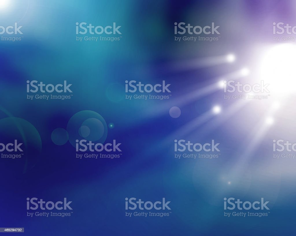 A blue and purple background with lights stock photo