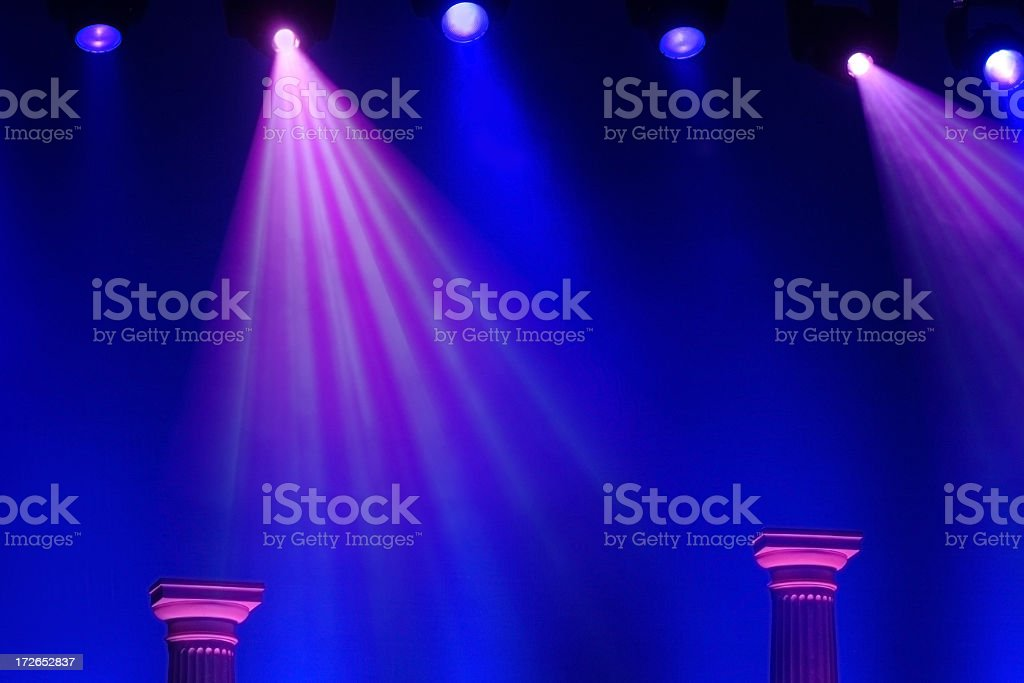 Blue and Purple Stage Lights with Two Roman Columns stock photo