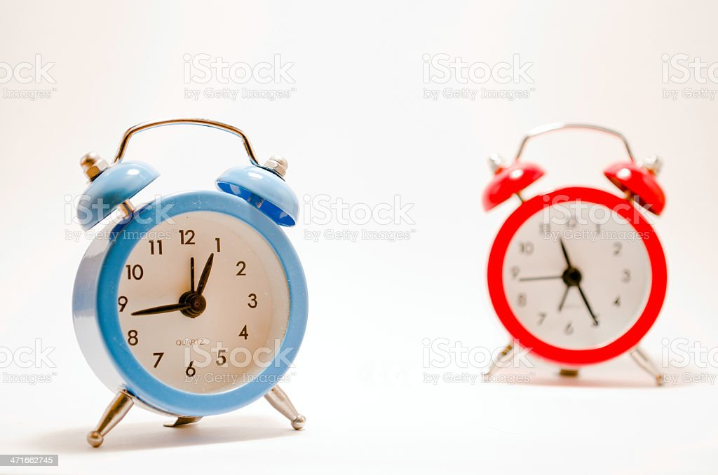 Blue and red alarm clocks royalty-free stock photo