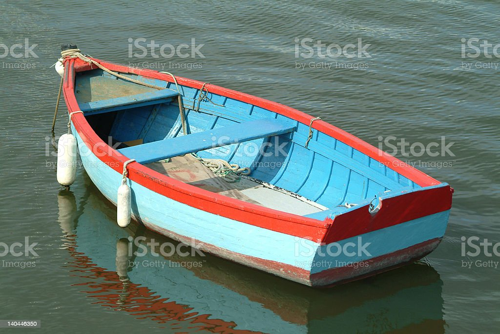 Blue and red boat royalty-free stock photo