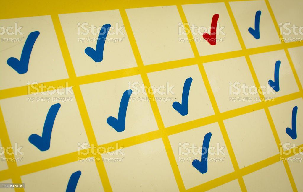 Blue and red checkmarks stock photo