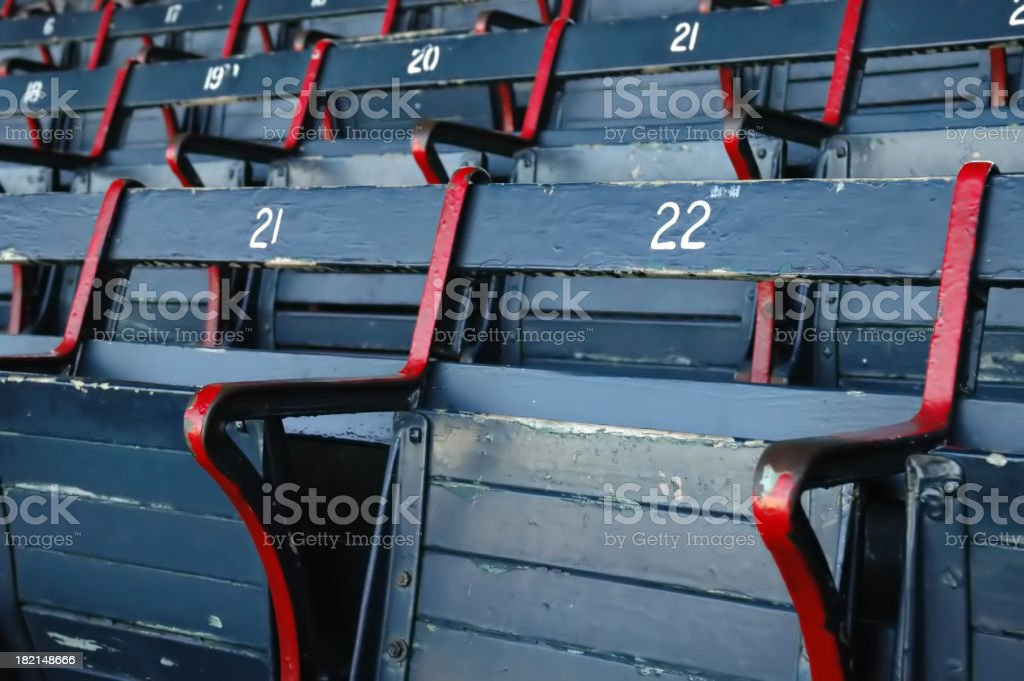Blue and red empty stadium seats stock photo