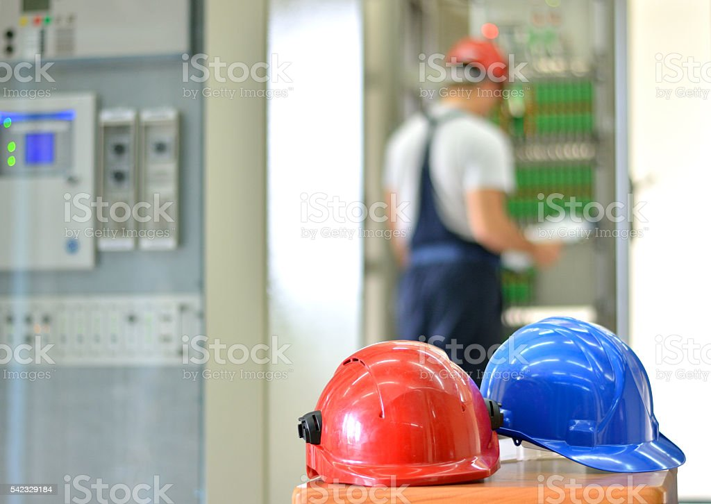 Blue and Red Hardhat in Electric Room stock photo