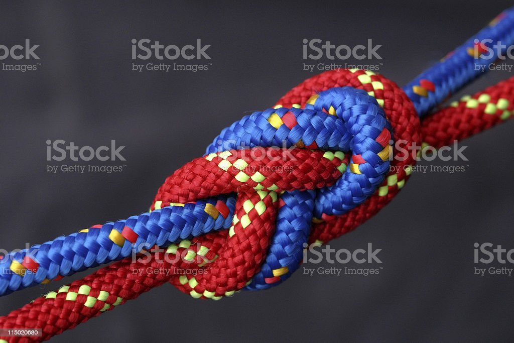 A blue and red rope intertwined stock photo