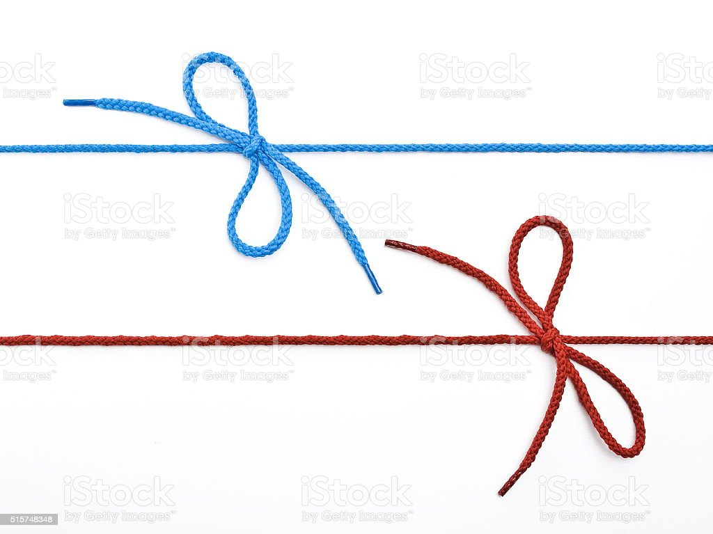 Blue and red shoelace with bow stock photo