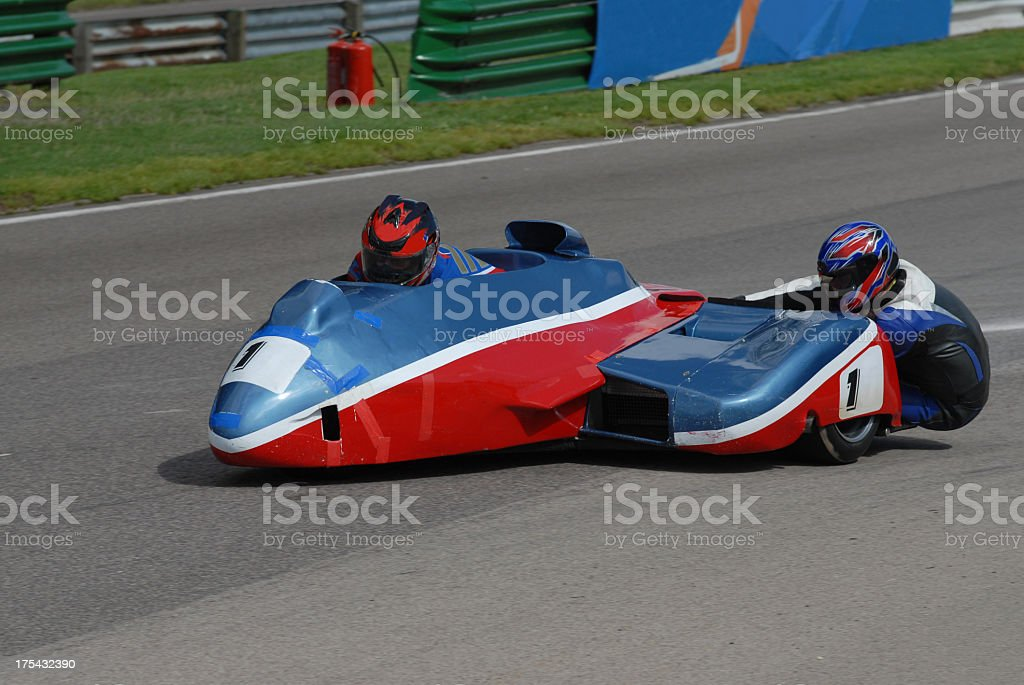 Blue and red sidecar racer stock photo