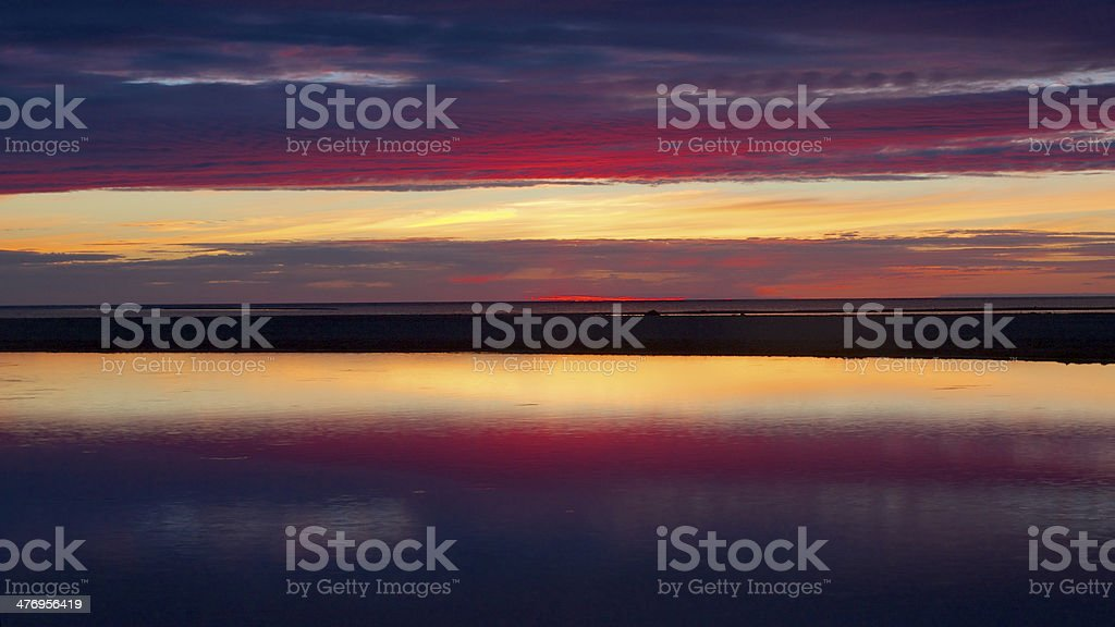 Blue and red sunset in Kalajoki reflecting in sea stock photo