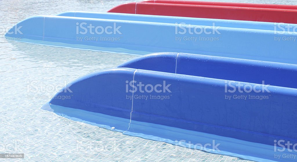 blue and red water slides stock photo