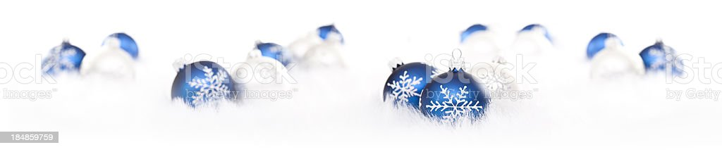 Blue and Silver Baubles on Snow royalty-free stock photo