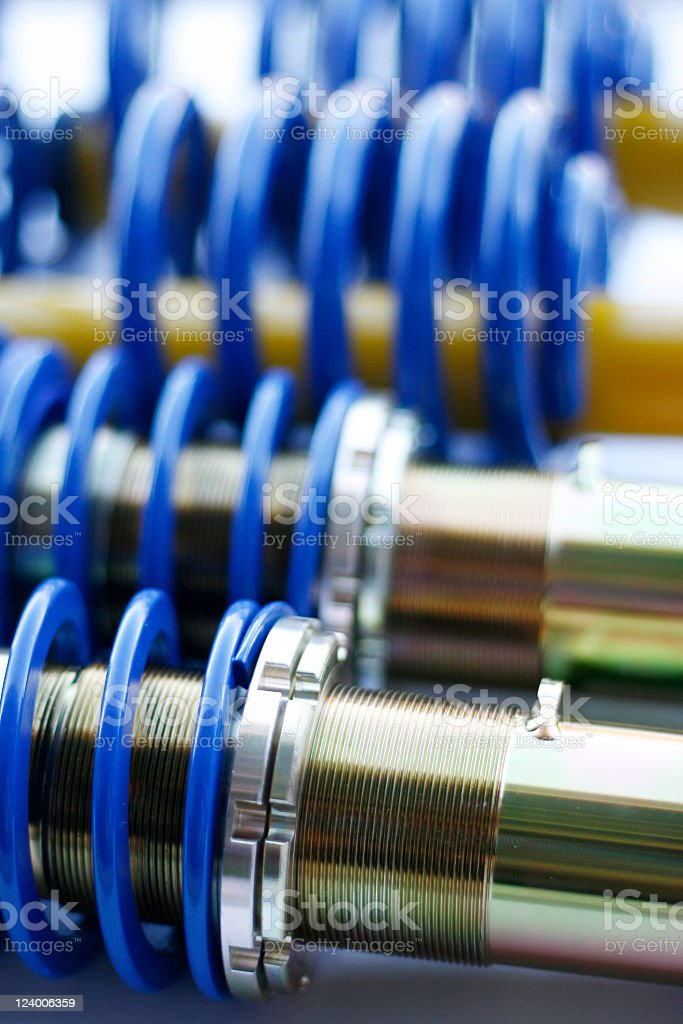 Blue and silver mechanical coil springs stock photo
