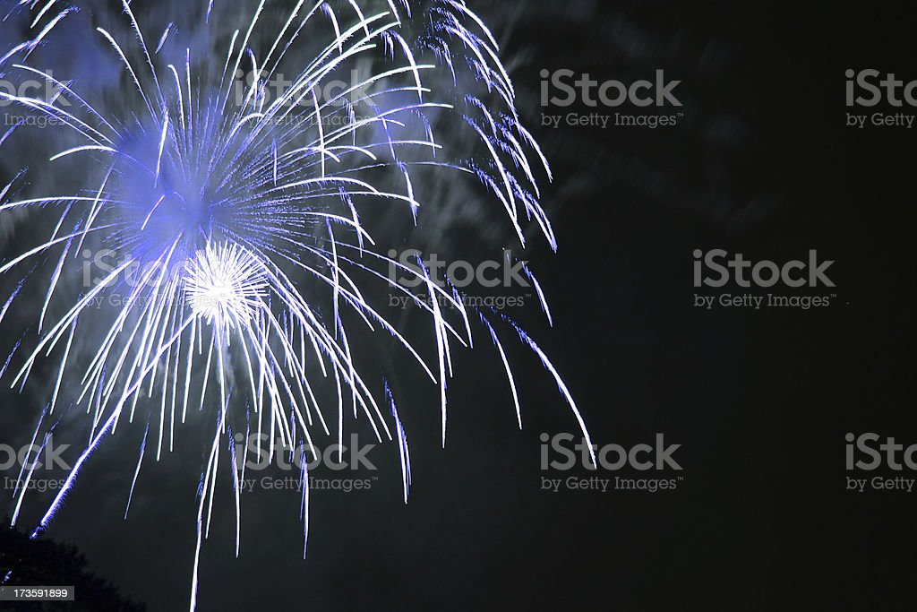 Blue and white 4th of July fireworks royalty-free stock photo