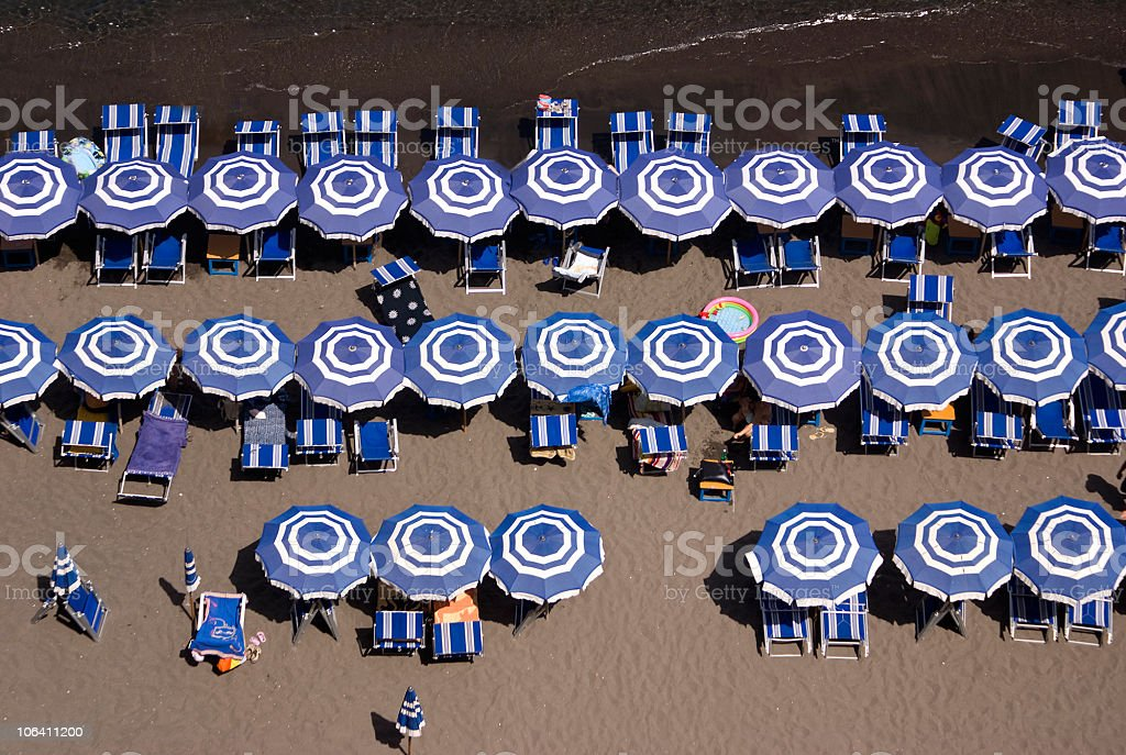 Blue and White Beach umbrellas,Sorrento,Italy stock photo