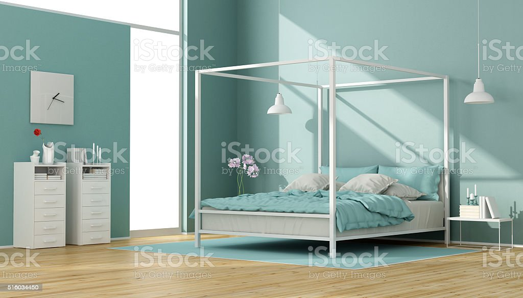 Blue and white bedroom with canopy bed stock photo