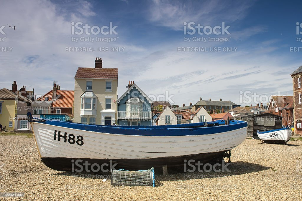 Blue and white boats on Aldeburgh beach, Suffolk, UK stock photo