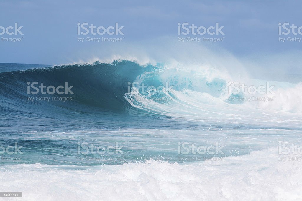 Blue and white breaking waves in the sea stock photo