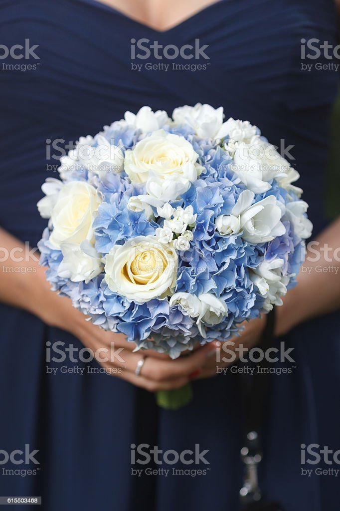 Blue and white bridal bouquet stock photo