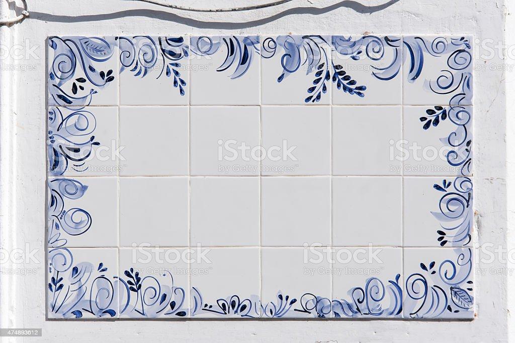Blue and white ceramic tile panel stock photo