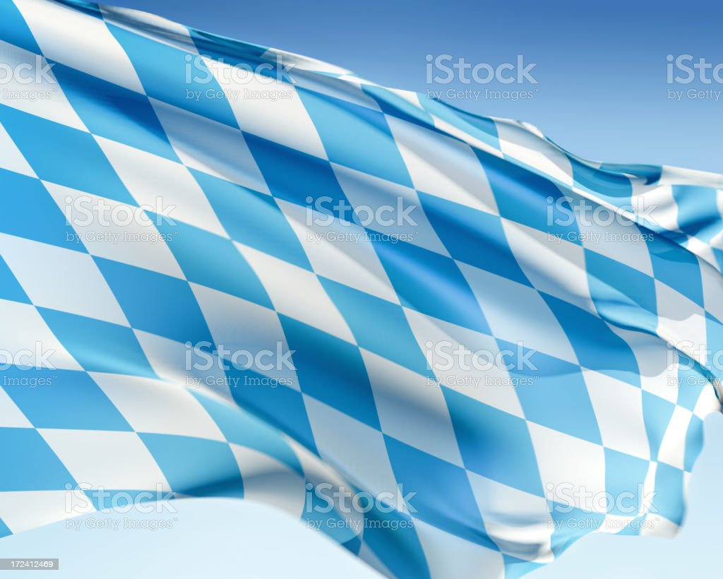 Blue and white checked Bavarian flag against blue sky stock photo
