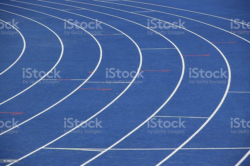 Blue and white empty athletics track stock photo