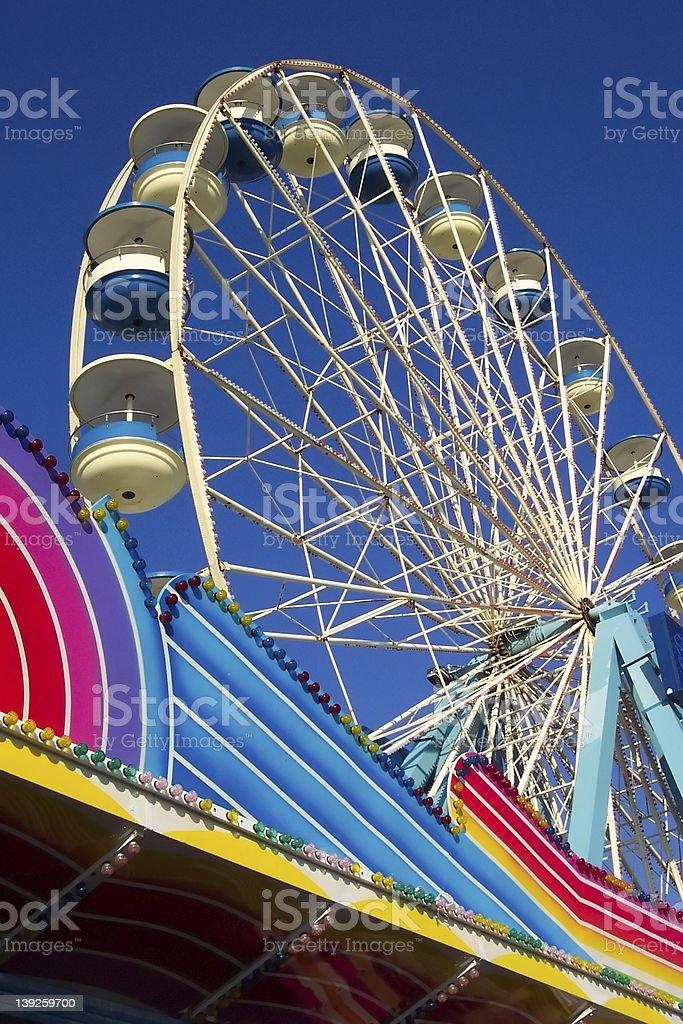 Blue and white fairground wheel stock photo
