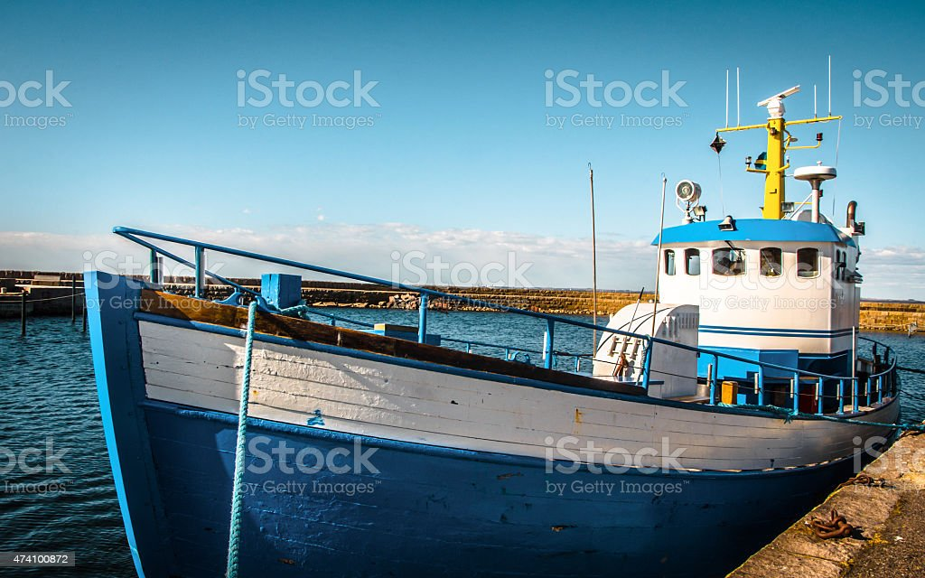 Blue and white fishing boat docked - Sweden stock photo