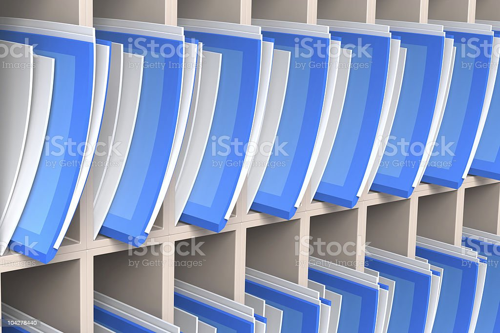 Blue and white folders neatly organized in a white cabinet royalty-free stock photo