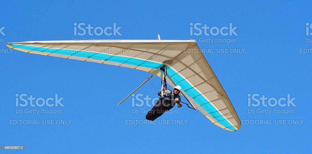 Blue and white hang glider stock photo