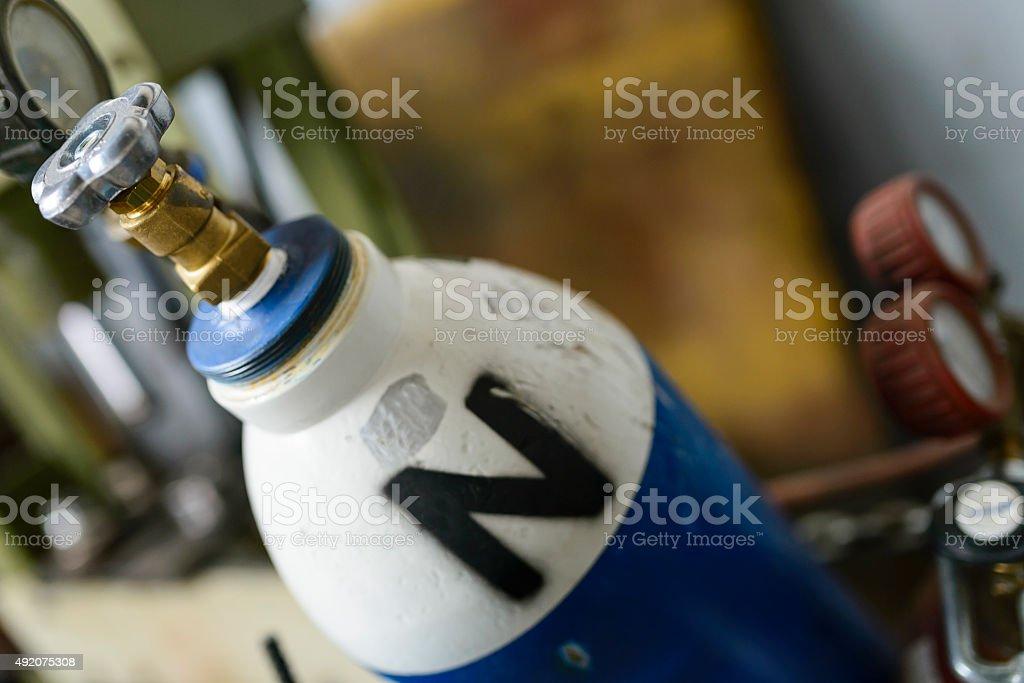 Blue and white oxygene gas bottles stock photo