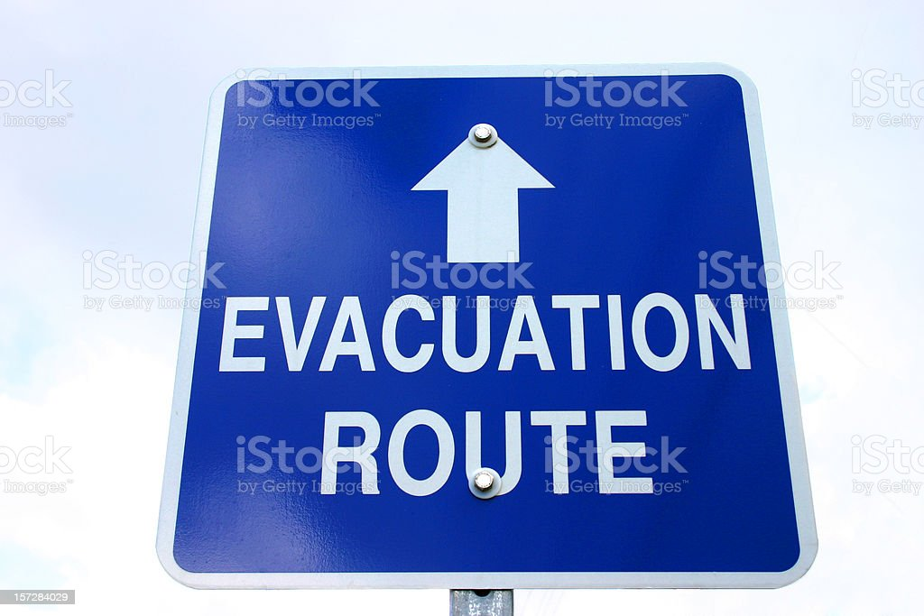Blue and white sign with evacuation route on and arrow stock photo