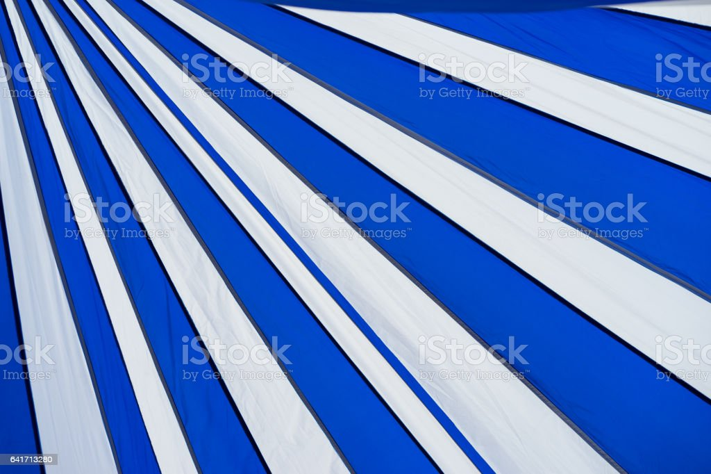 Blue and white striped canvas tent roof stock photo