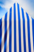 blue and white striped tents on the beach of Dinard