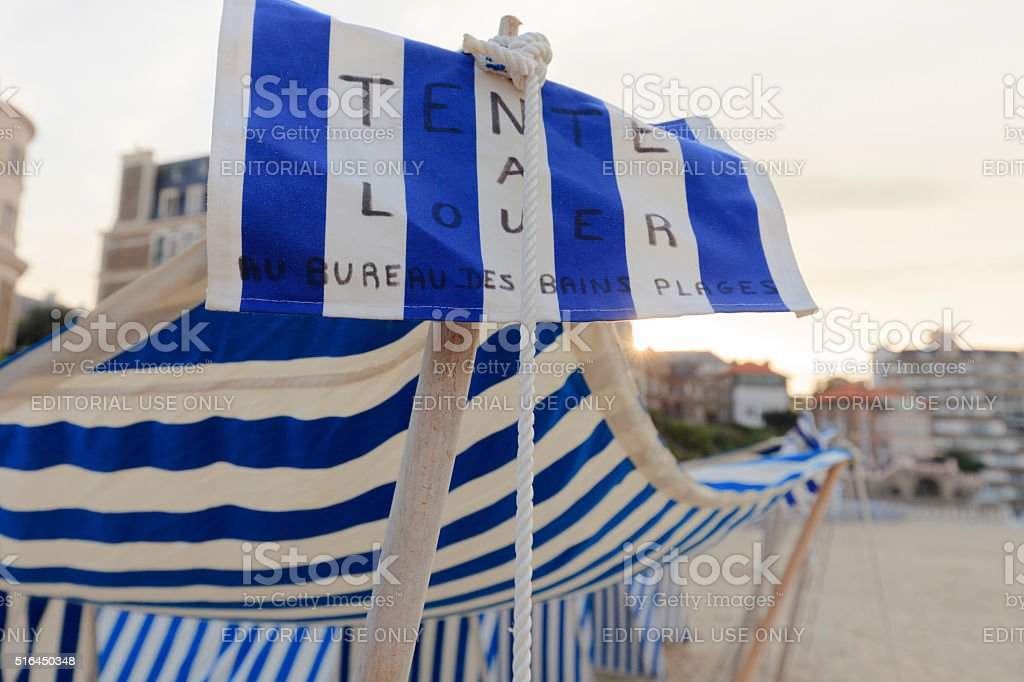 blue and white striped tents on the beach of Dinard stock photo