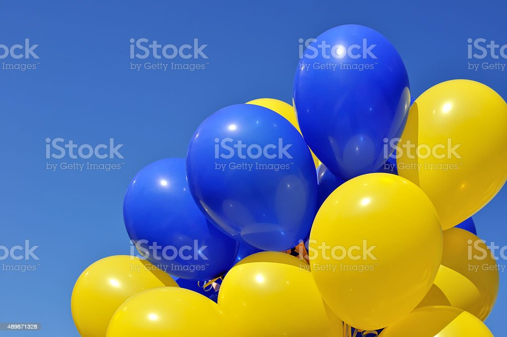 blue and yellow balloons in the city festival stock photo