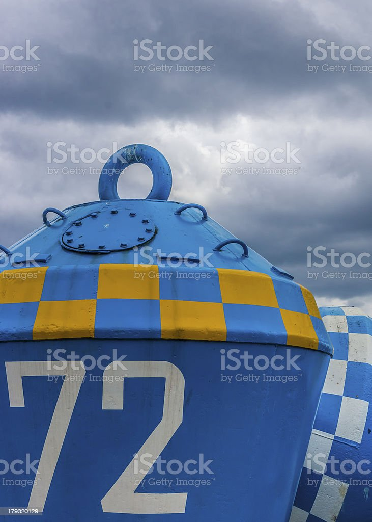 Blue And Yellow Buoy stock photo