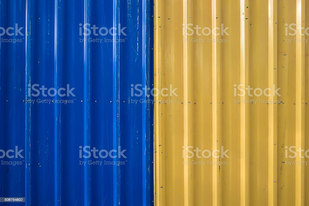 Blue and Yellow corrugated Iron Fence stock photo