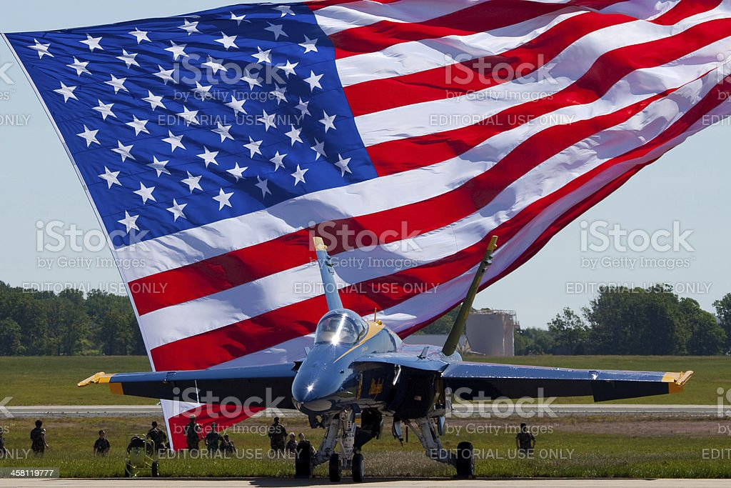 Blue Angel F-18 with American flag in the background stock photo