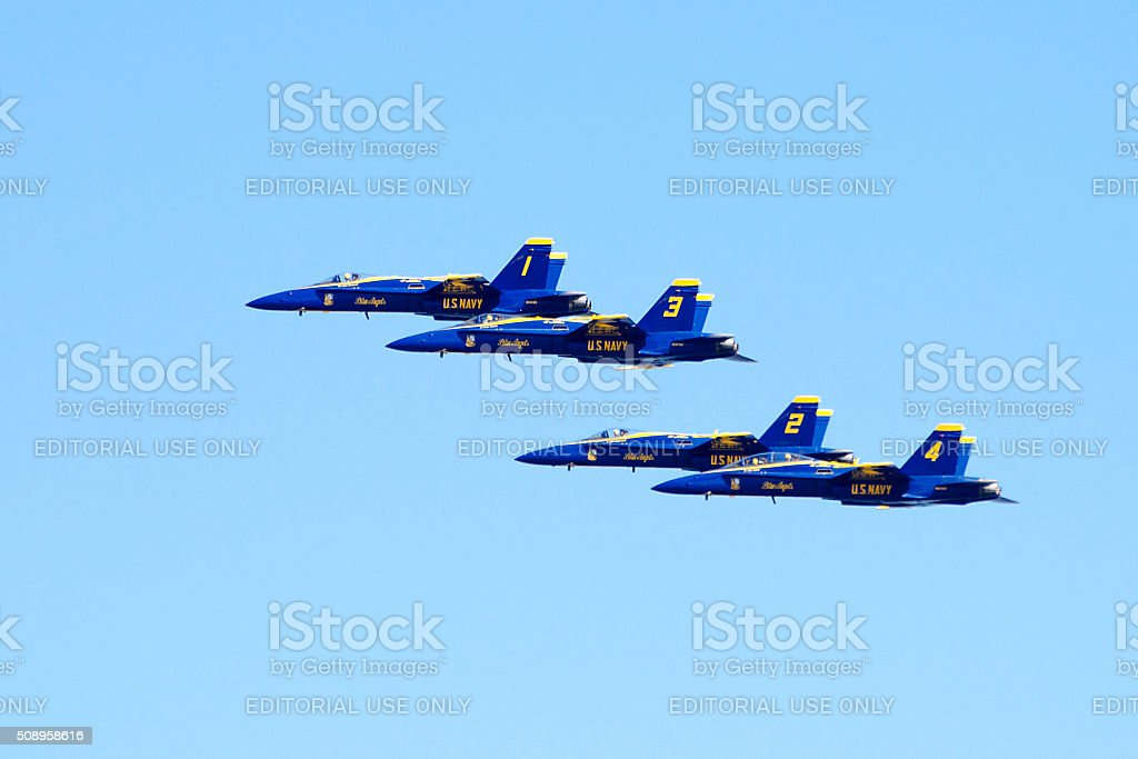 Blue Angels flying in clear blue sky stock photo