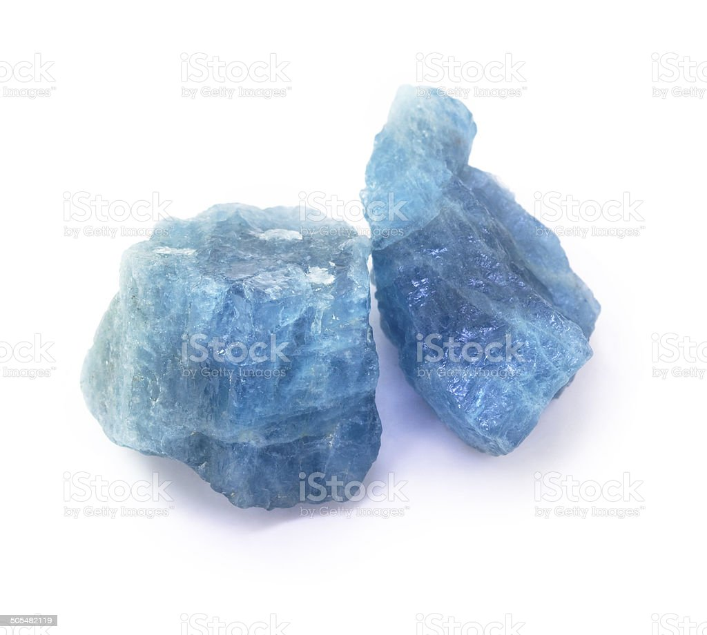 Blue aquamarine raw gemstones on the white background. stock photo