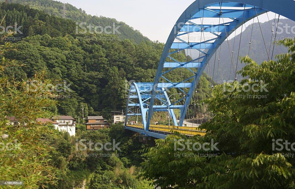 Blue Arch Bridge over the Yoshino River, Shikoku, Japan stock photo