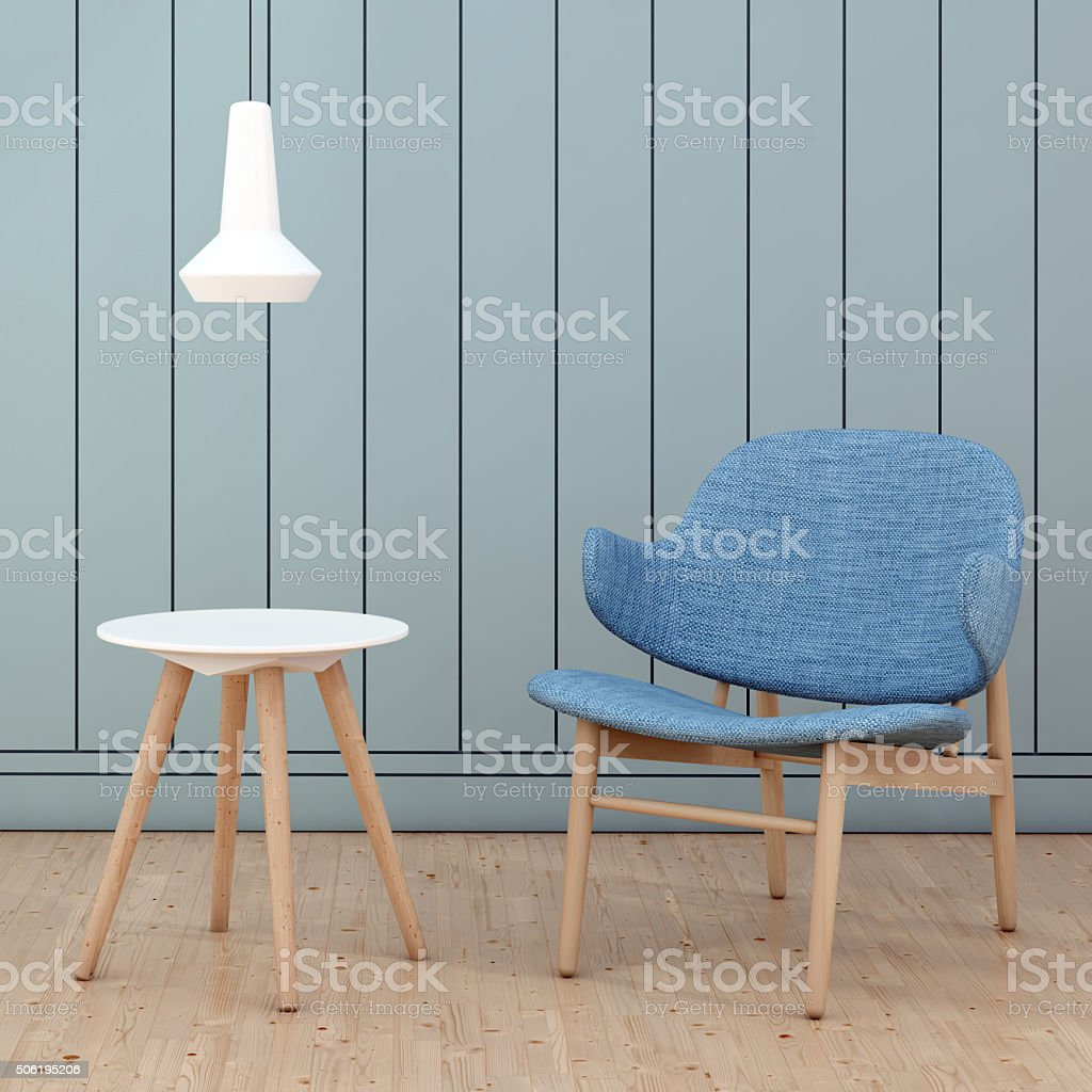 Blue armchair in front of a wall square close up stock photo